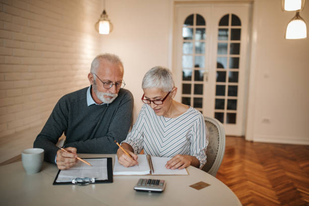 A senior couple taking a closer look at their budget in the comfort of their home.